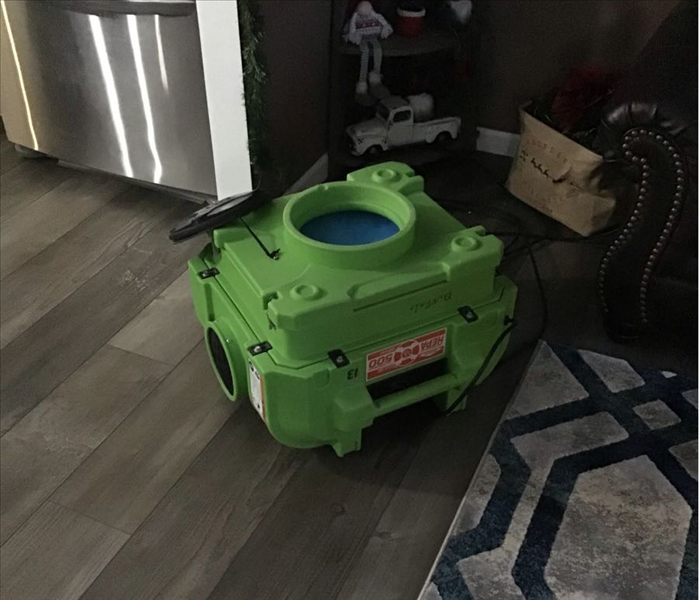 A SERVPRO deodorizer in a living room