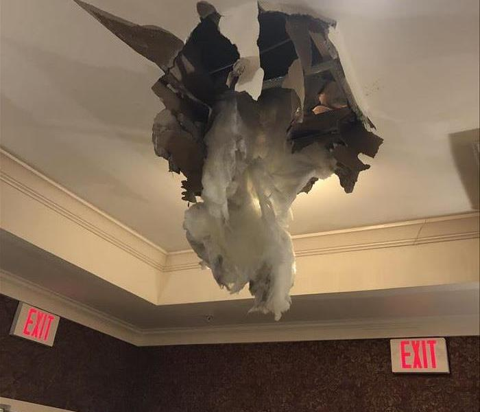 A pipe broke in the ceiling causing drywall to fall down and water leaking out